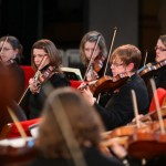 Violin section, Kent Sinfonia tour by OLA Asia